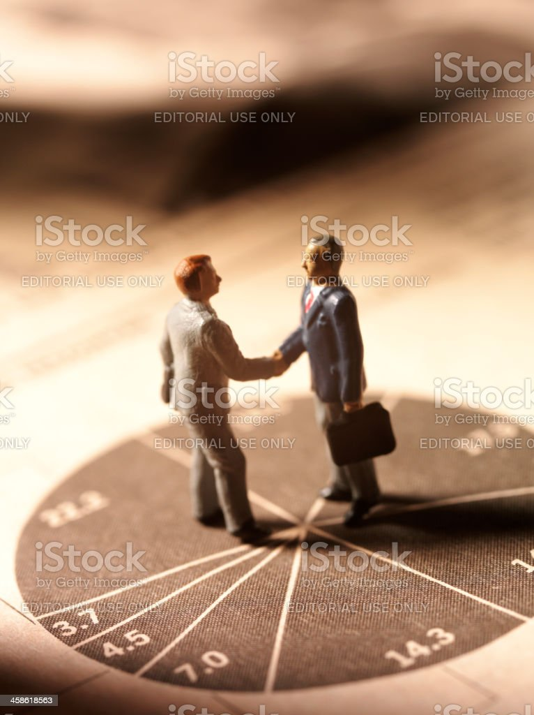Pie Chart and Business Men stock photo