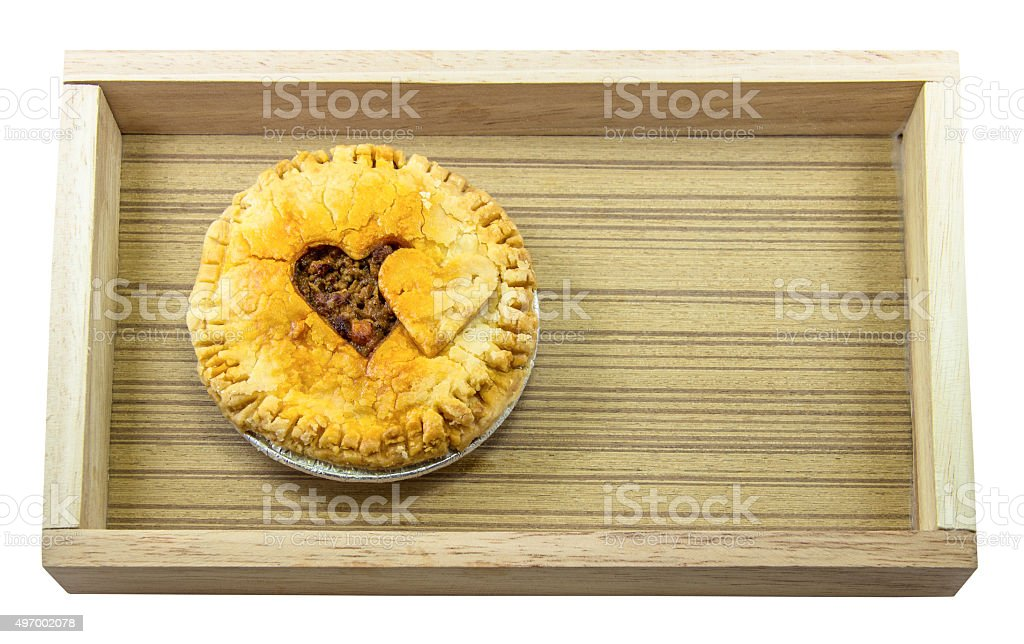 Pie heart shaped on wood box stock photo