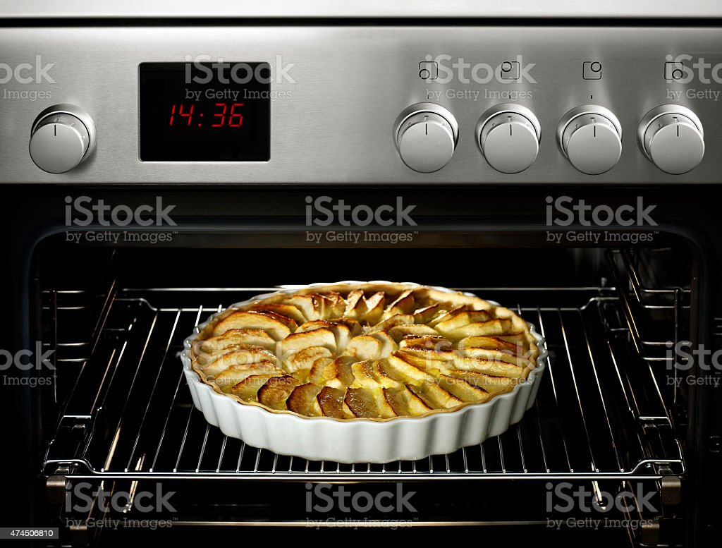 pie in an oven stock photo