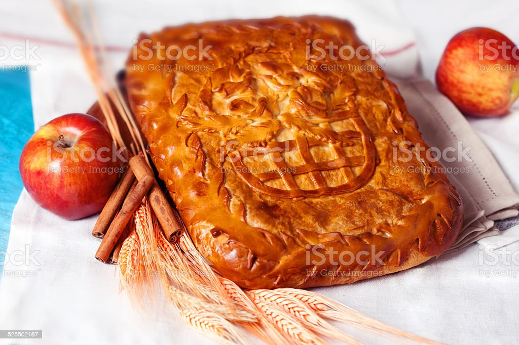pie pastry with apple and cinnamon in a still life stock photo
