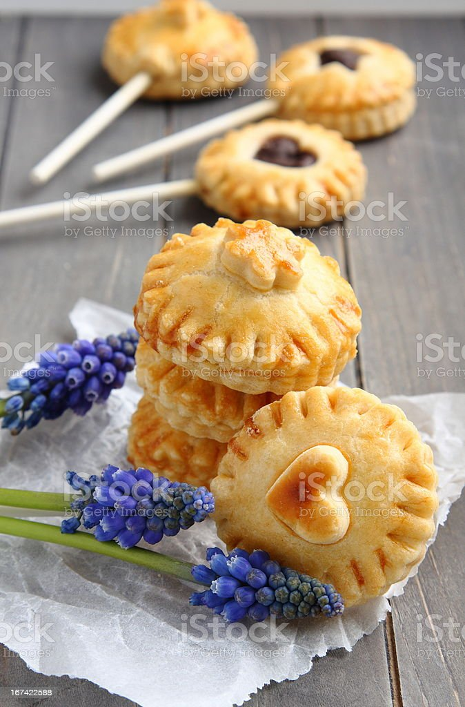 Pie pops with chocolate and muscari flowers royalty-free stock photo