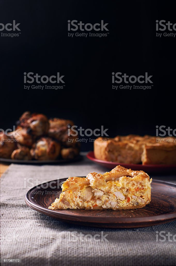 Piece of a chicken meat pie on plate stock photo