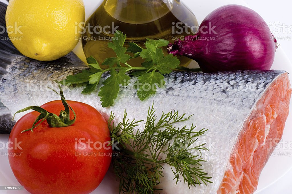 Piece of a salmon with vegetable royalty-free stock photo