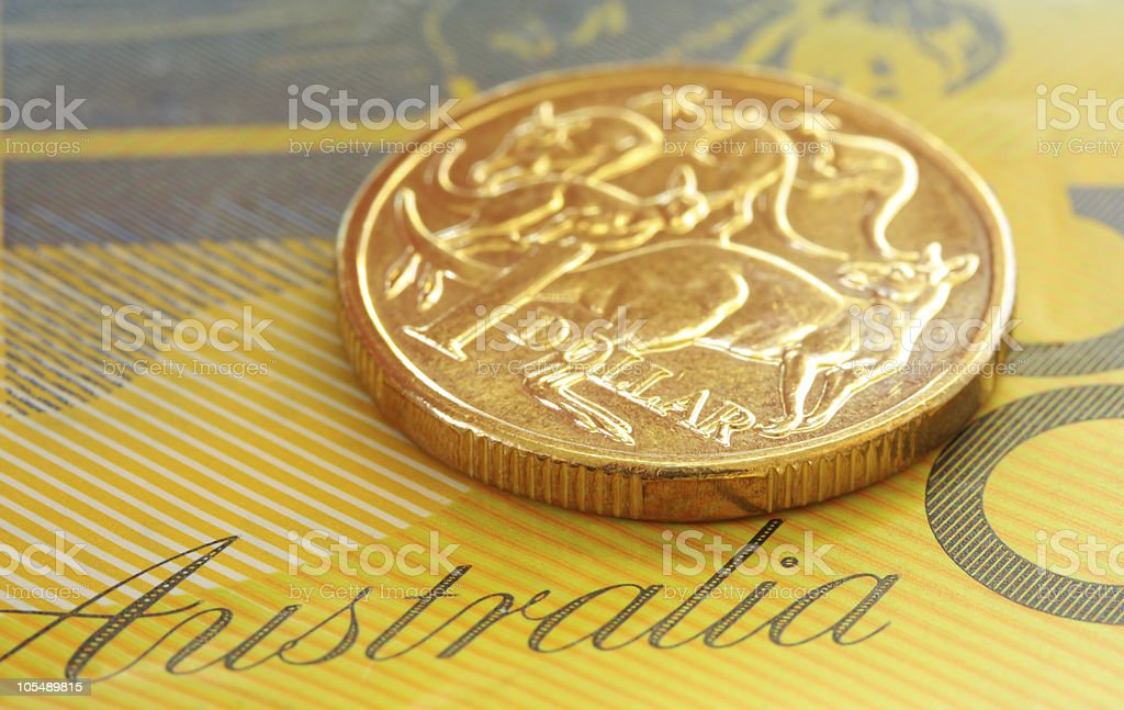 A piece of Australian currency on top of a paper  stock photo