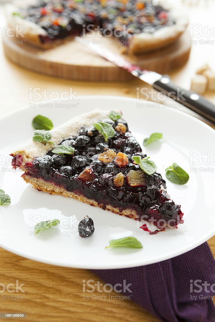 piece of berry pie on a white plate, leaf oregano royalty-free stock photo