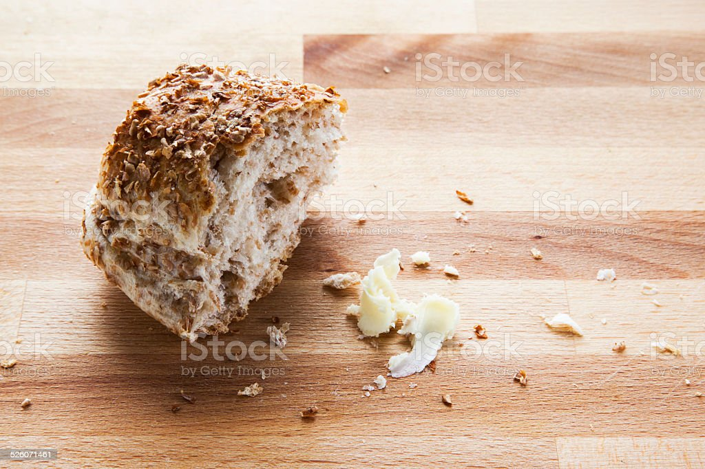 piece of bread on cutting board with butter cream stock photo