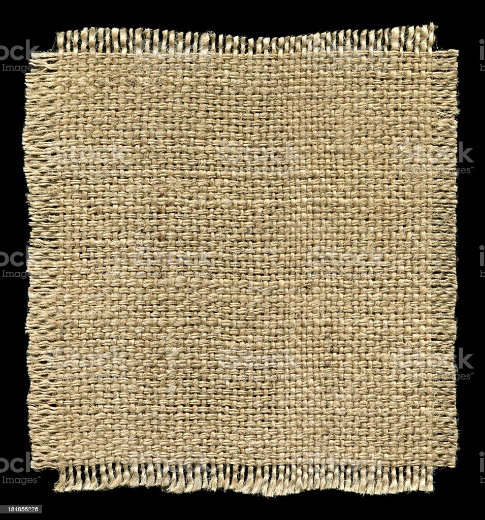 Piece of Burlap textured isolated on black background stock photo