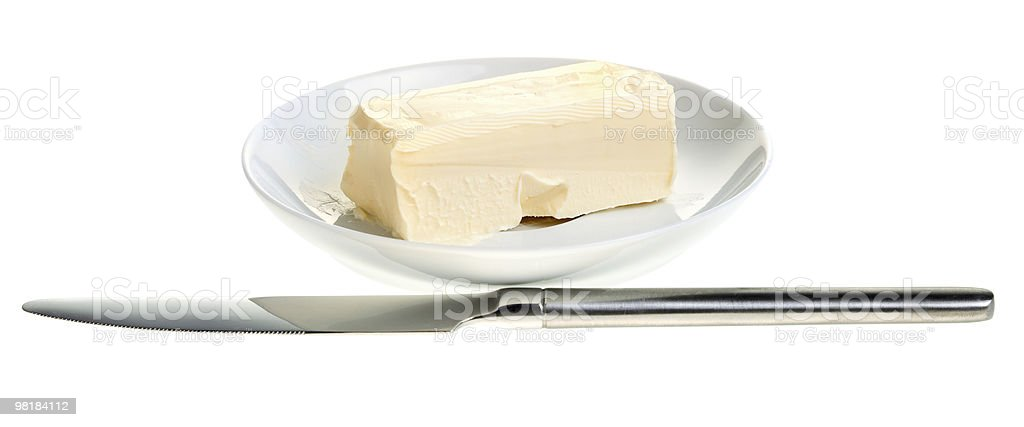 piece of butter on a saucer and knife stock photo