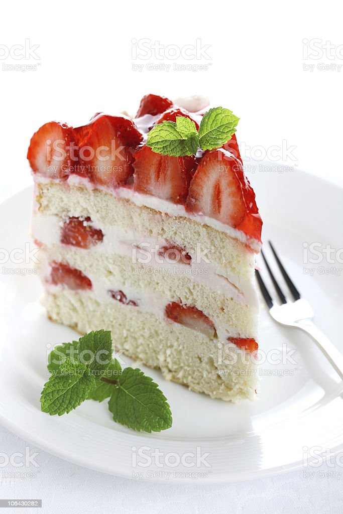 piece of cake on white plate with strawberries royalty-free stock photo