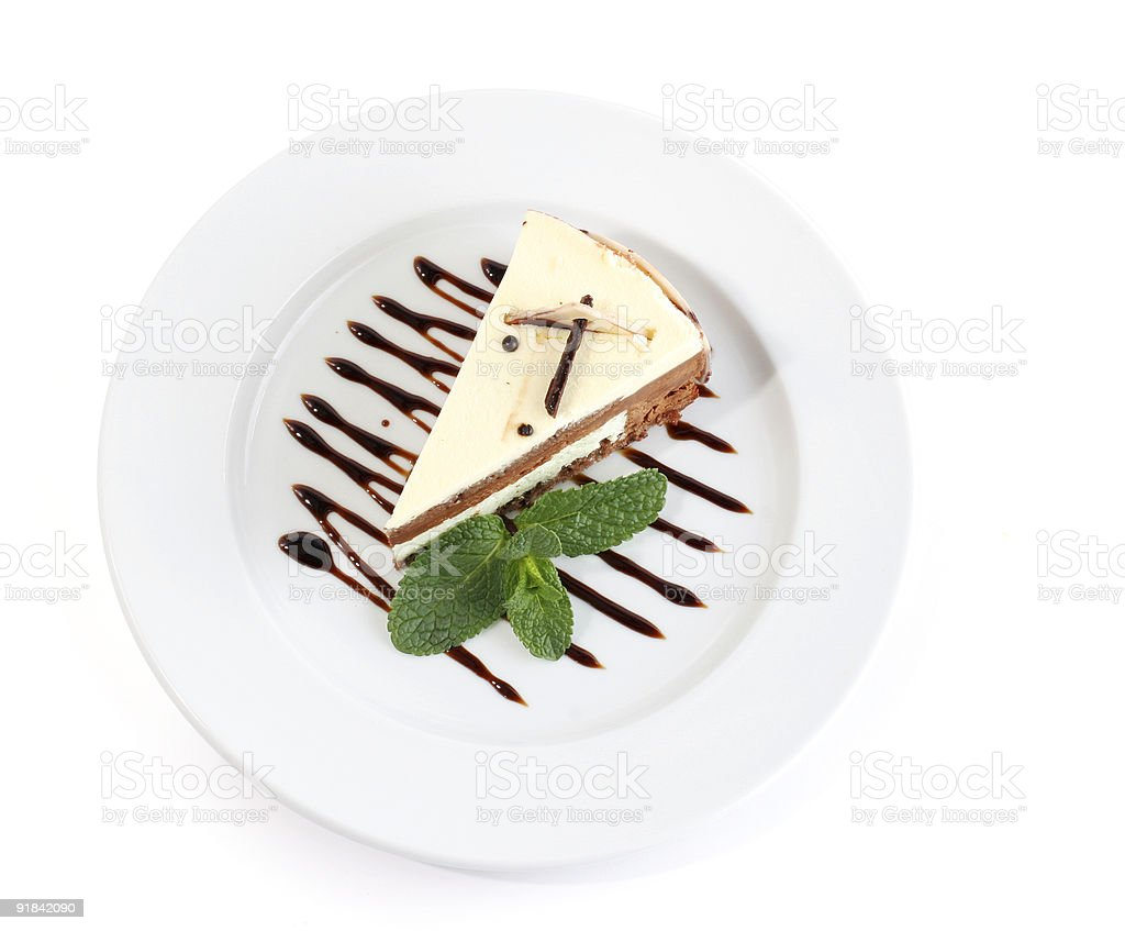 A piece of cake with chocolate syrup royalty-free stock photo