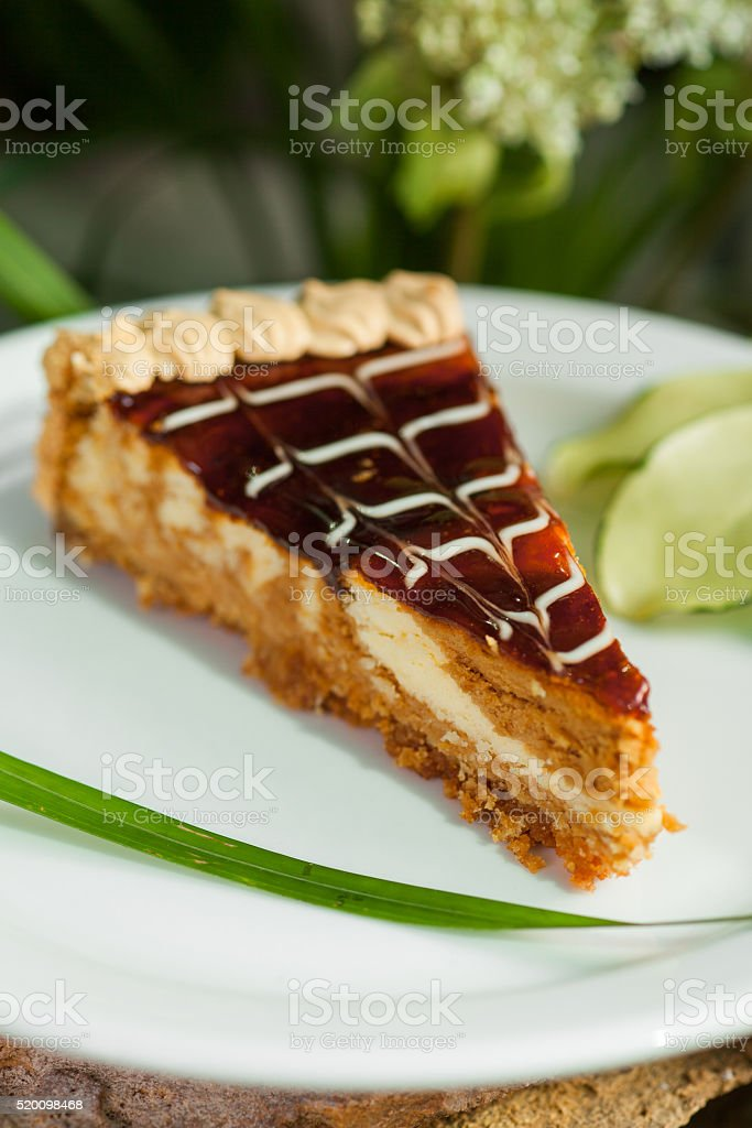 piece of cake with fruit jam, topped with whipped cream stock photo