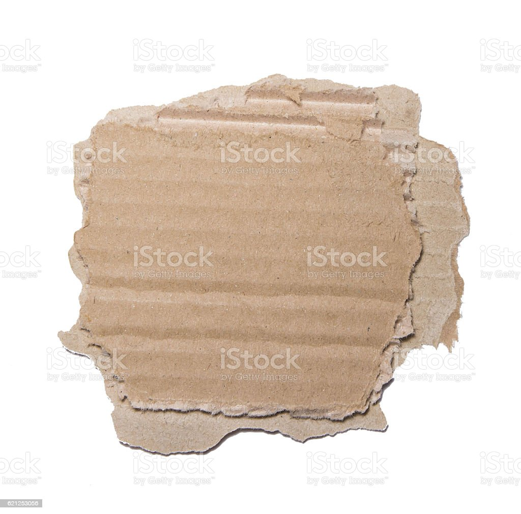 Piece of cardboard with torn edges. stock photo
