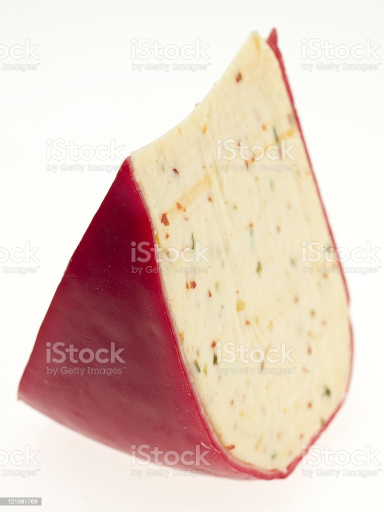 Piece of cheddar cheese with jalapeno and cayenne spices royalty-free stock photo