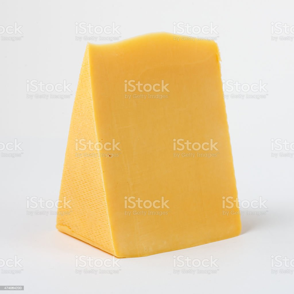 piece of cheese on a white background stock photo