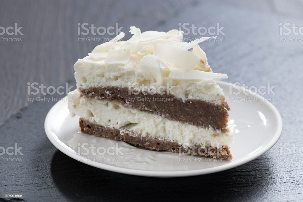piece of chocolate cake with coconut cream stock photo