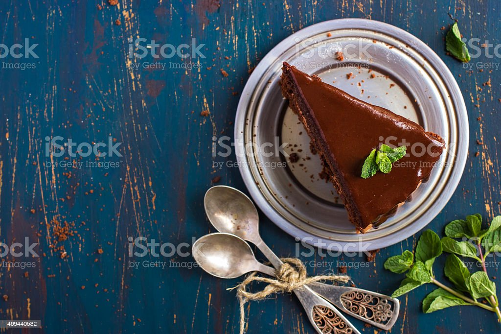 piece of chocolate cake with mint leaves, top view stock photo