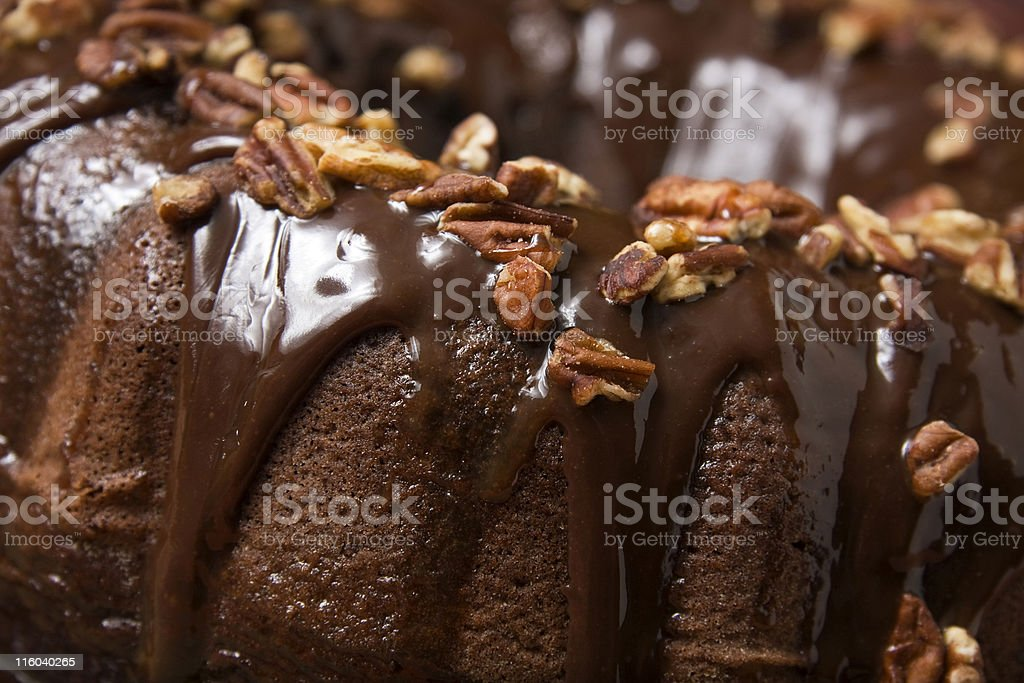 A piece of chocolate cake with nuts for a topping  royalty-free stock photo