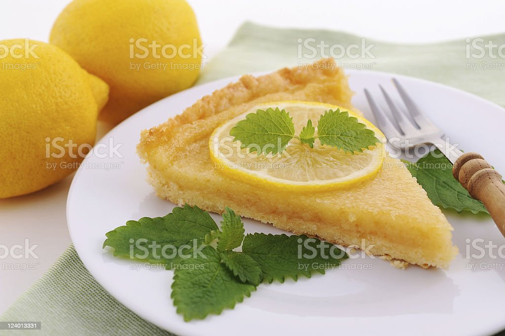 Piece of Citron Tart with Mint and Fork stock photo