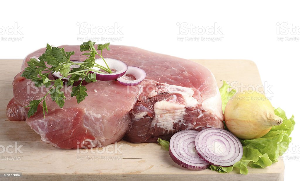 Piece of crude meat with spices. royalty-free stock photo
