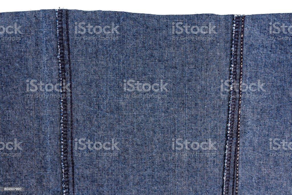 Piece of dark blue jeans fabric stock photo