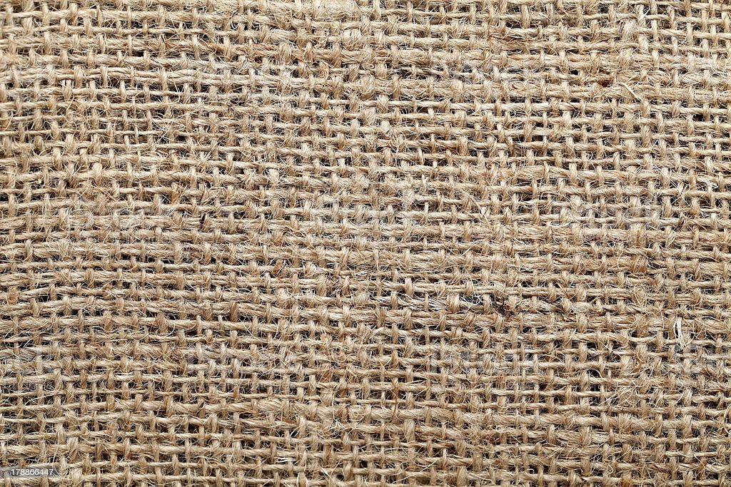 Piece of frayed burlap on background royalty-free stock photo