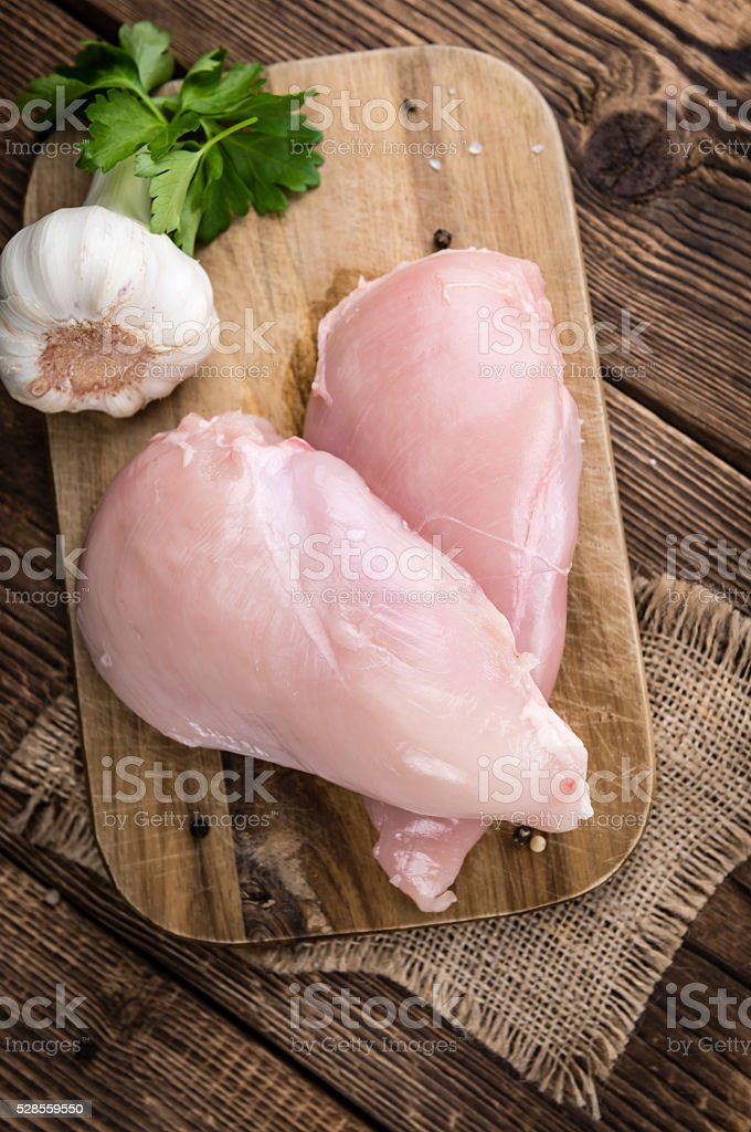 Piece of fresh Chicken Fillet (close-up shot) stock photo