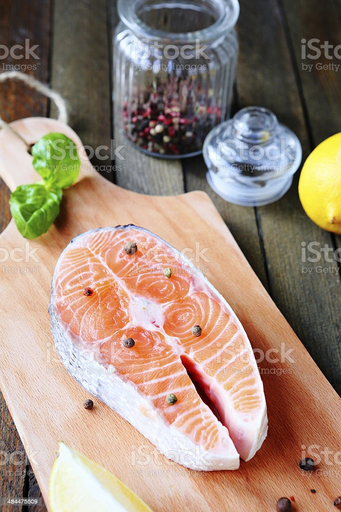 piece of fresh fish on a cutting board royalty-free stock photo