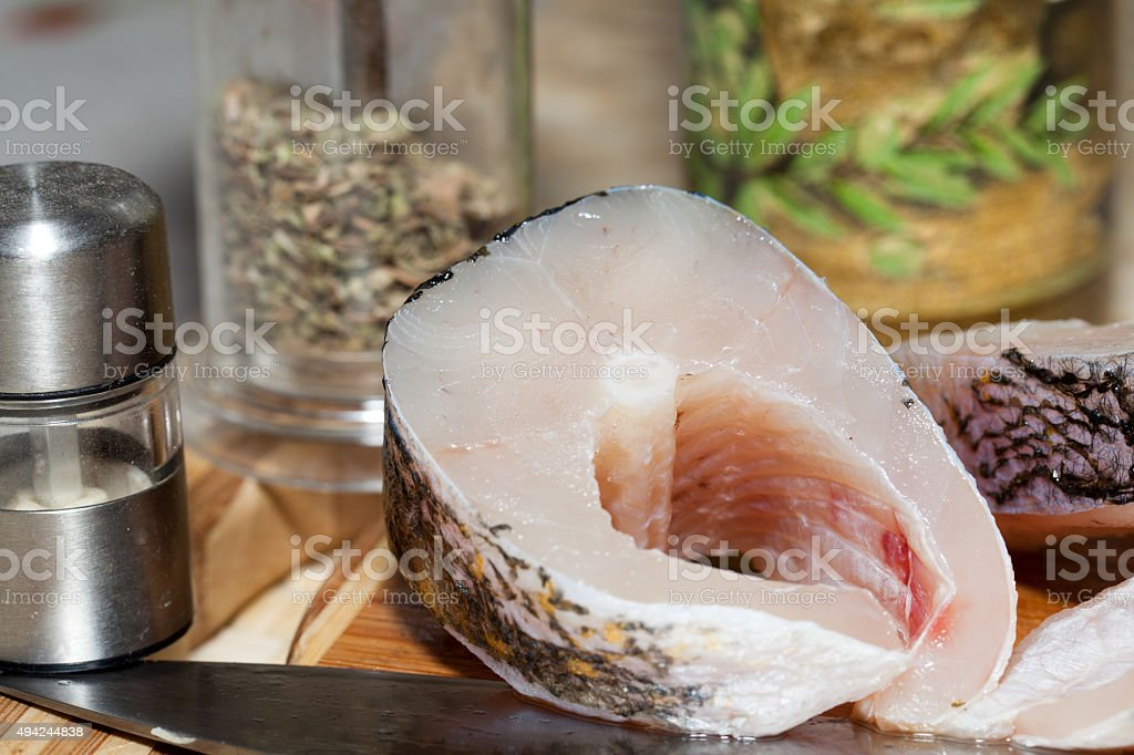 Piece of fresh raw fish stock photo