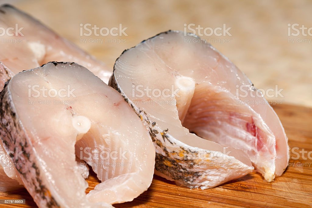 Piece of fresh raw fish. stock photo