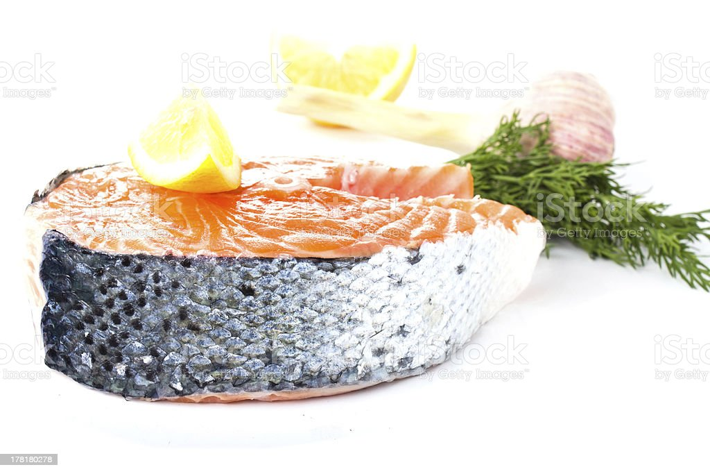 Piece of fresh salmon steak on a white background royalty-free stock photo