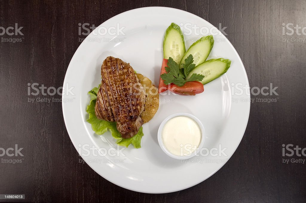 Piece of fried meat with vegetables. royalty-free stock photo