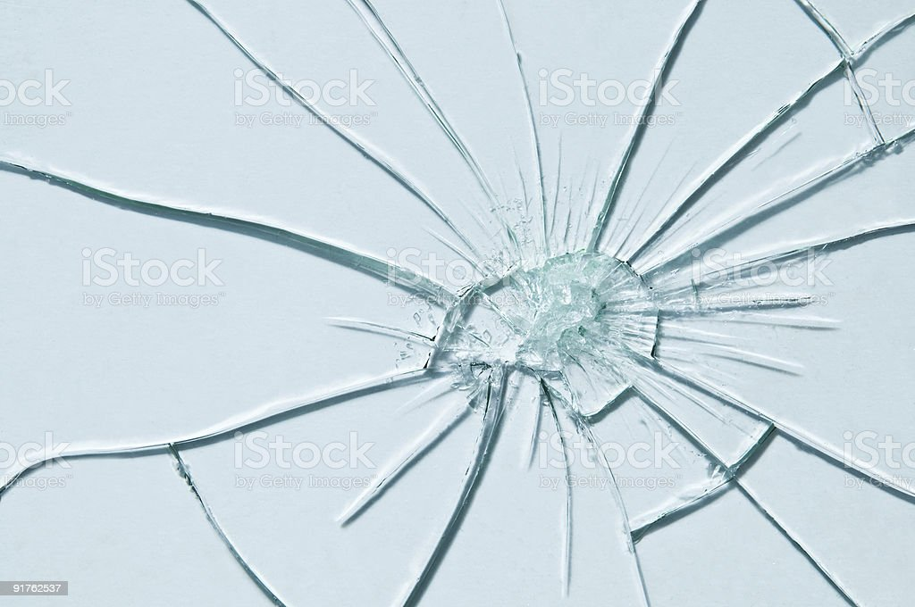 A piece of glass that has been shattered  stock photo