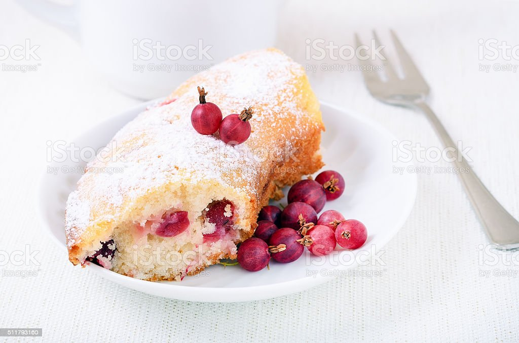 Piece of gooseberries pie and powdered sugar stock photo