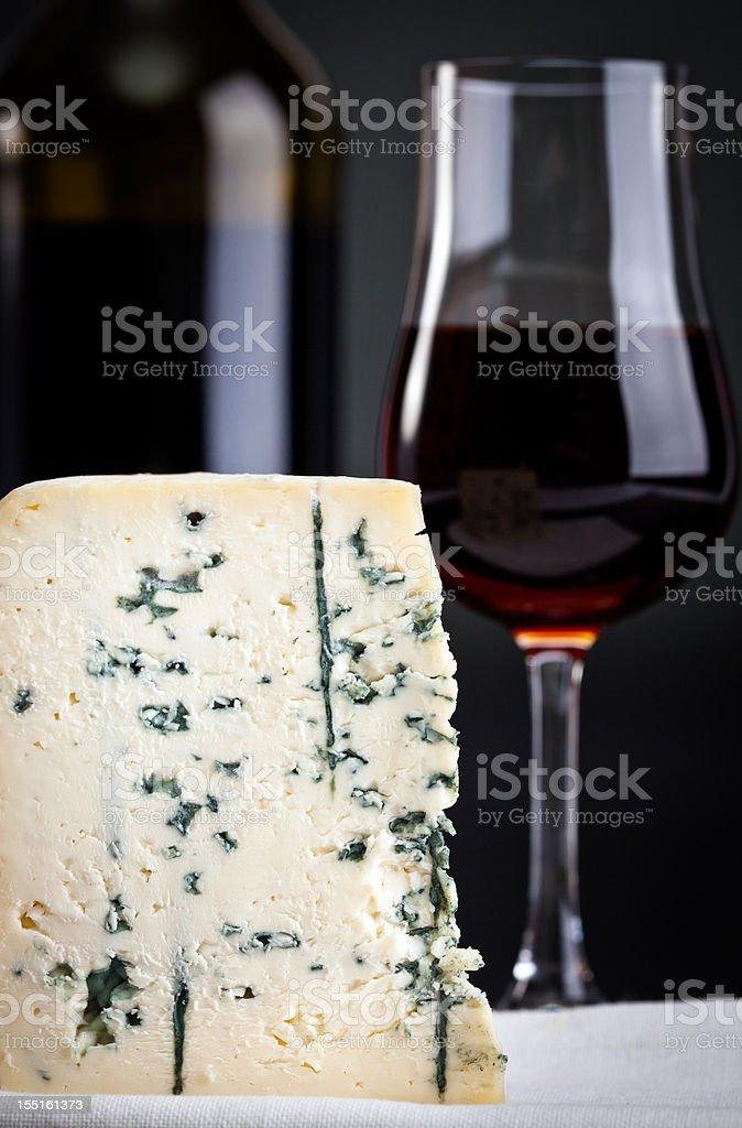 Piece of Gorgonzola and Madeira wine stock photo
