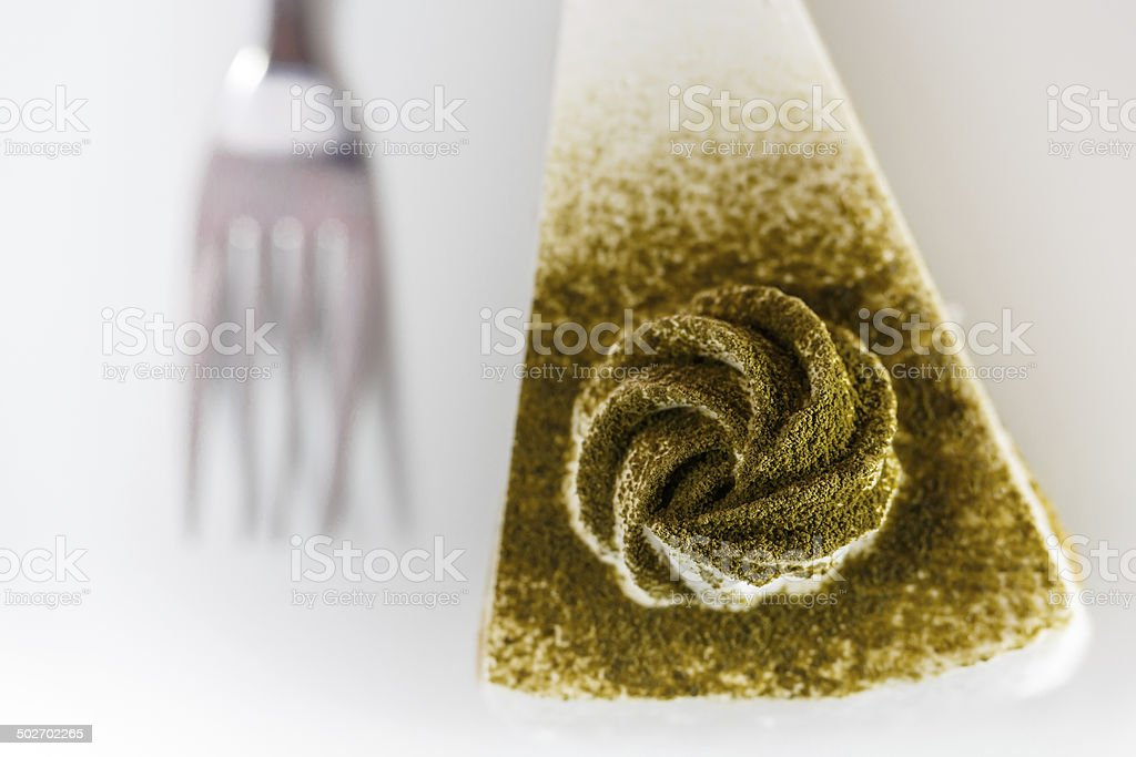 Piece of green tea cake stock photo