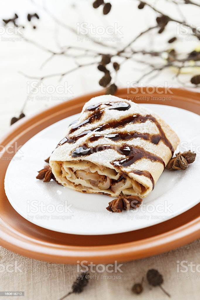 Piece of homemade apple pie on a plate close up royalty-free stock photo