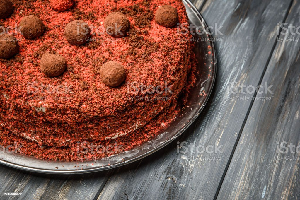 Piece of homemade berry cake on the wood background stock photo