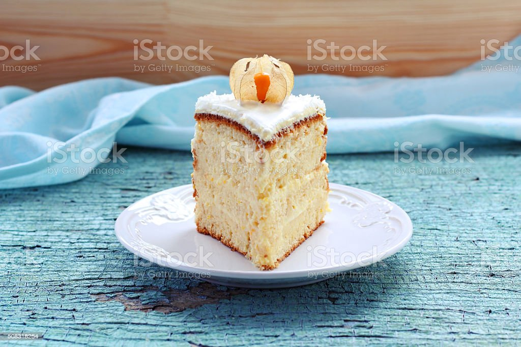 piece of homemade cake decorated with winter cherry stock photo