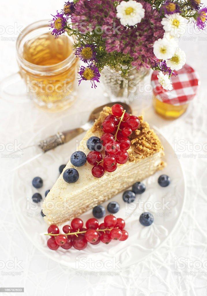 Piece of homemade honey cake with fresh berries royalty-free stock photo
