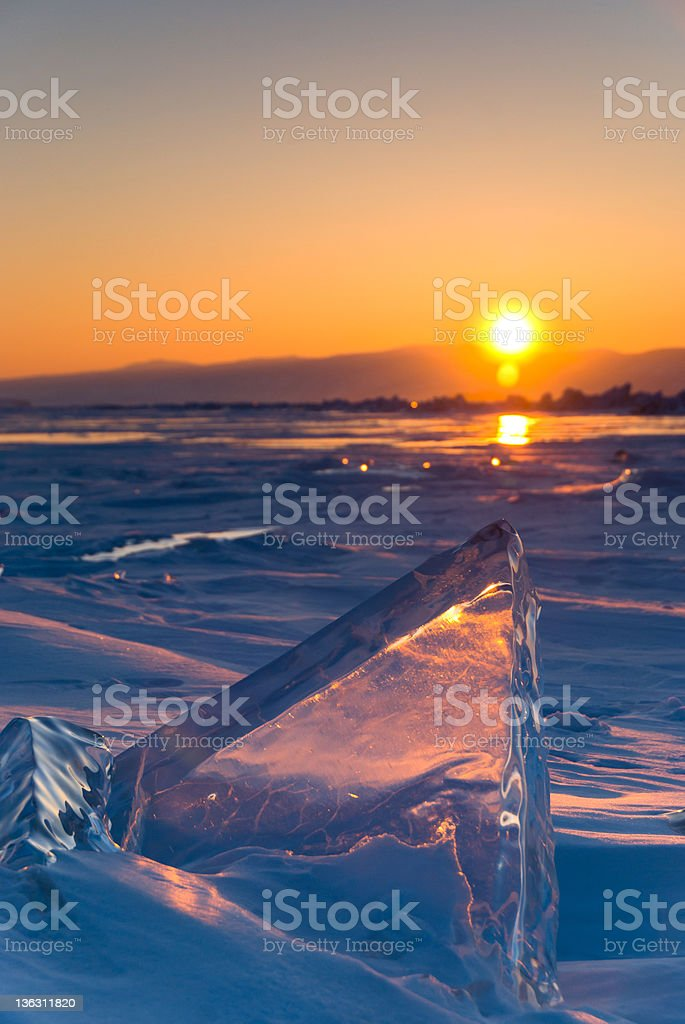 Piece of ice at the frozen lake Baikal on sunset royalty-free stock photo