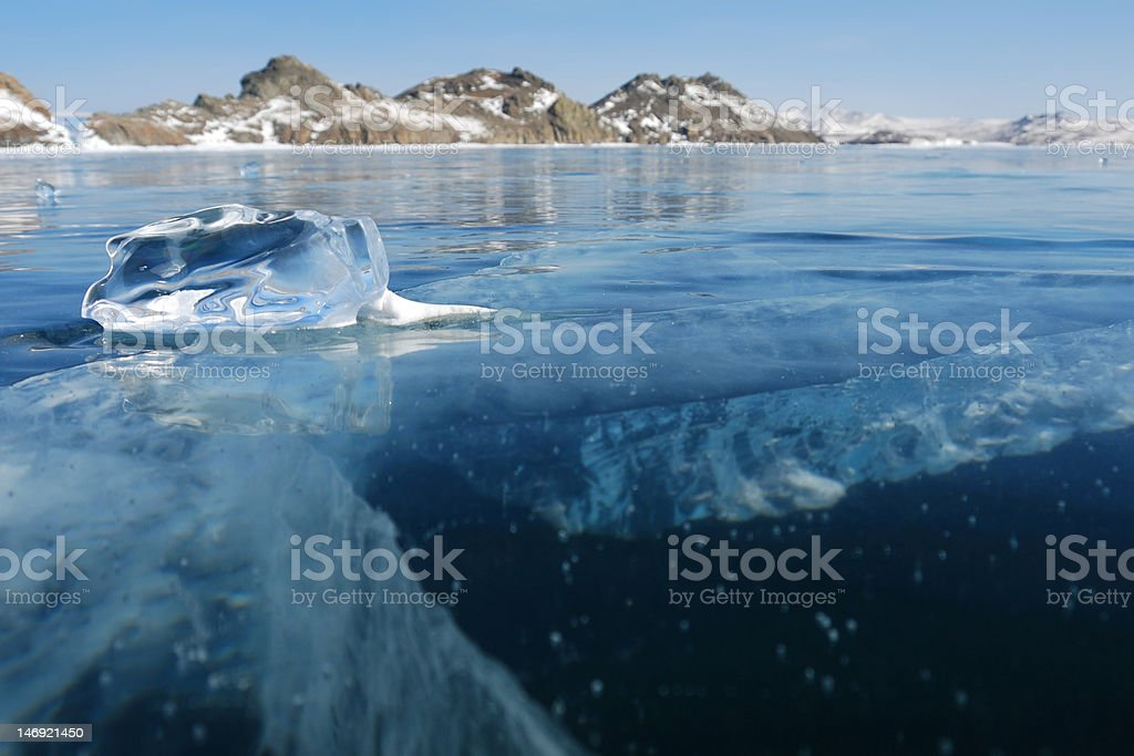 Piece of ice on the frozen lake stock photo