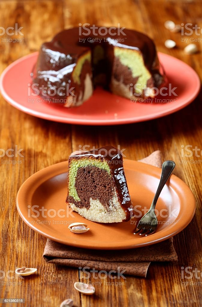 Piece of Marble Pistachio, Chocolate and Vanilla Cake stock photo