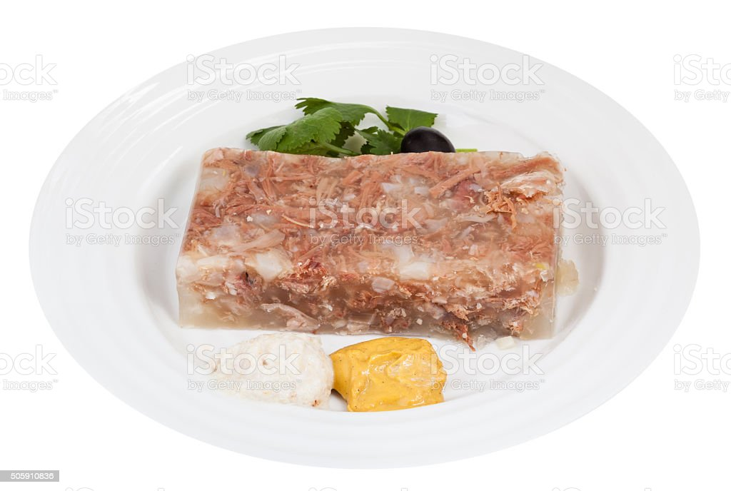 piece of meat aspic with seasonings on white plate stock photo
