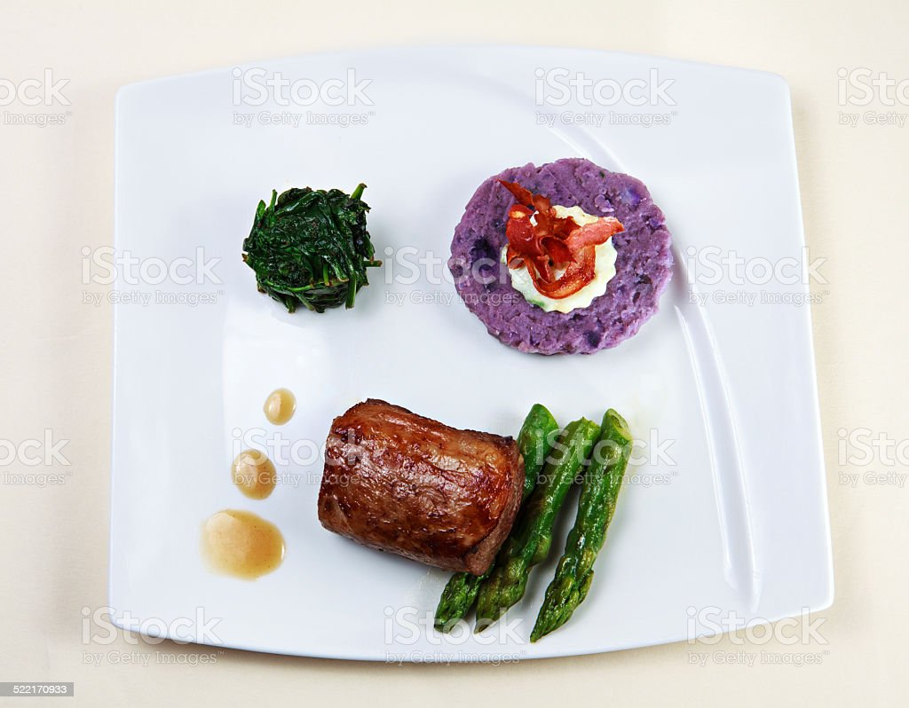 piece of meat with vegetables stock photo