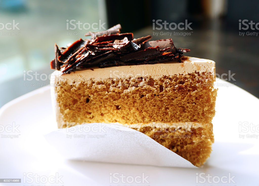 Piece of mocca coffee cake on white plate stock photo