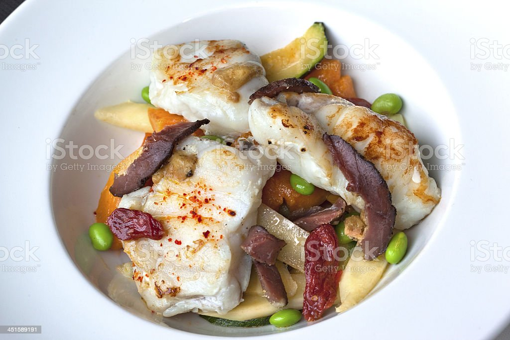 Piece of monkfish on a plate royalty-free stock photo
