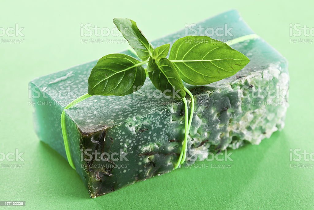 Piece of natural soap with basil royalty-free stock photo