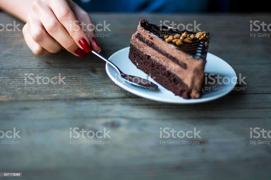 Piece of of chocolate cake on the table stock photo