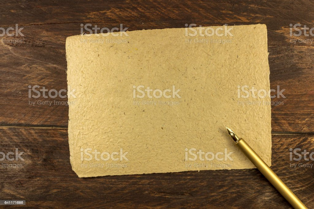 Piece of old parchment with ink pen and copyspace stock photo