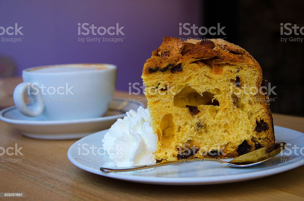 Piece of Panettone with  coffee stock photo